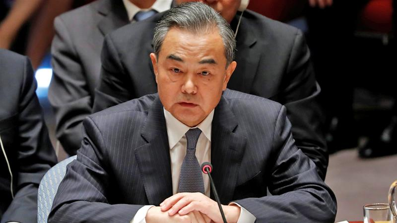 Foreign Minister Wang Yi listens to Trump address the UN Security Council on Wednesday [Carlos Barria/Reuters]