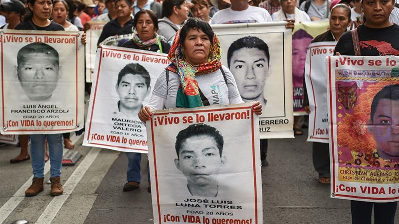 Students and activists take part in a demonstration to mark the fourth anniversary of the disappearance of 43 students of the teaching training school in Ayotzinapa [Rodrigo Arangua/AFP]