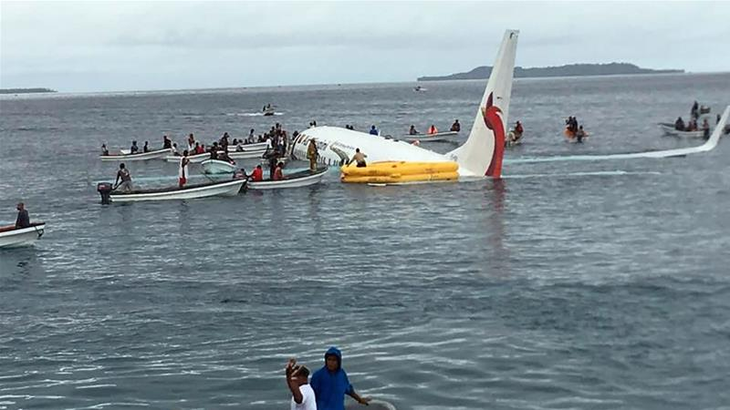 The Boeing 737-800 aircraft hit the water short of the runway while trying to land at Chuuk Island [James Yaingeluo/AFP]