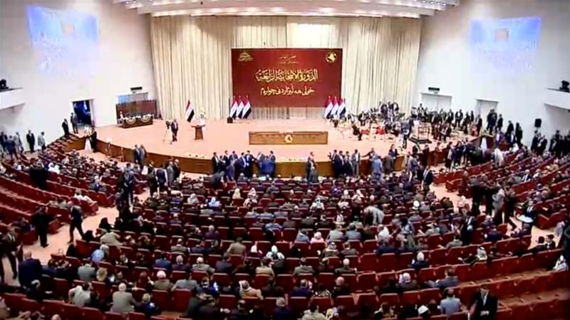 Iraqi legislators gathered for opening session of the new parliament in Baghdad [Reuters]
