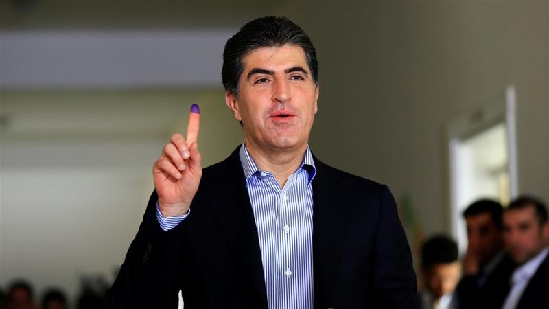 Prime Minister Nechirvan Barzani of the KDP cast his vote shortly after polls opened on Sunday morning [Thaier Al-Sudani/Reuters]