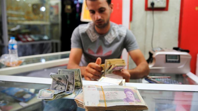 Iranian rials are seen at a currency exchange shop in Baghdad, Iraq August 8, 2018 [Khalid Al-Mousily/Reuters]