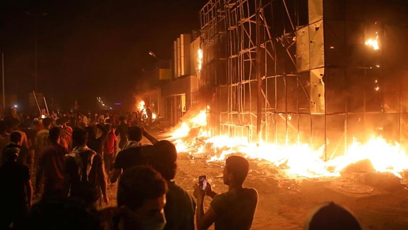 One protester has died from burns sustained during the torching of a local government office [Nabil al-Jurani/AP]
