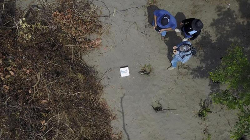 The remains were found in 32 burial pits in central Veracruz [Handout/ AP]