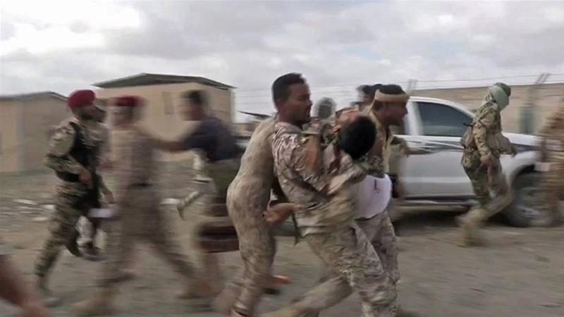 Wounded Yemeni soldiers were carried from the scene after a drone exploded above [Screengrab: Nabil Hasan/AFP]