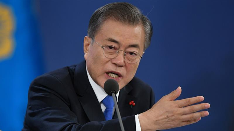 Moon Jae-in speaks to reporters at the presidential Blue House in Seoul [Jung Yeon-je/Pool via Reuters]