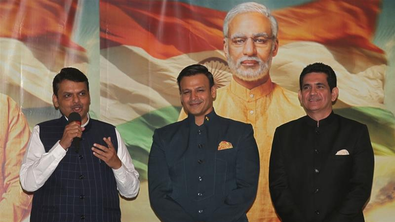 Maharashtra state Chief Minister Devendra Fadnavis (L) with actor Vivek Oberoi (C) and director Omung Kumar at the launch of the poster of 'PM Narendra Modi' [Francis Mascarenhas/Reuters]