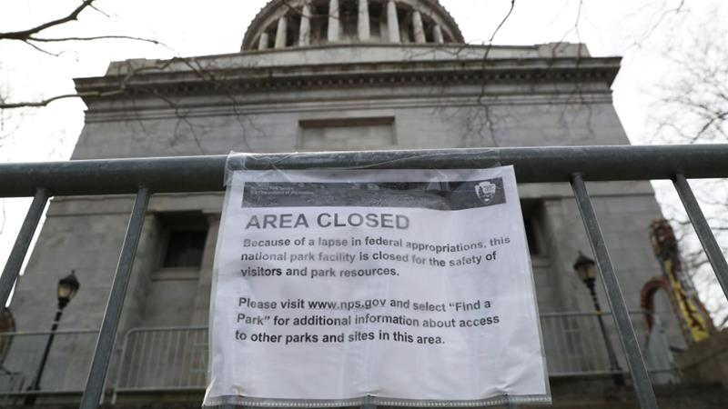 A sign says the General Grant National Monument is closed due to the partial government shutdown in New York [Shannon Stapleton/Reuters]