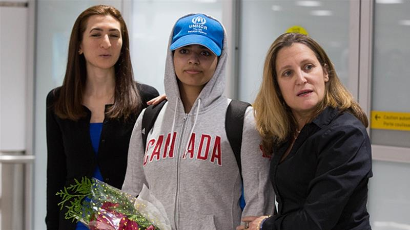 Rahaf Mohammed al-Qunun is welcomed by Canadian Minister for Foreign Affairs Chrystia Freeland (R) as she arrives at Pearson International airport in Toronto [Lars Hagberg/AFP]