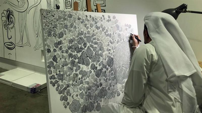 Al Mulla outlines themes of Sufism and other cultures with black lines on a white canvas [Ayilah Chaudhary/Al Jazeera]
