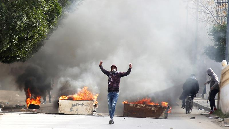 Protesters upset at economic hardship clash with police during demonstrations in Kasserine, Tunisia, last month [Amine Ben Aziza/Reuters]