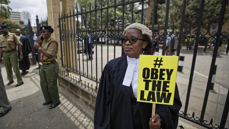 Mercy Wambua, CEO of the Law Society of Kenya, protests outside the Supreme Court after the deportation of an opposition politician in defiance of a court order on Feb 15, 2018 [File: AP/Ben Curtis]