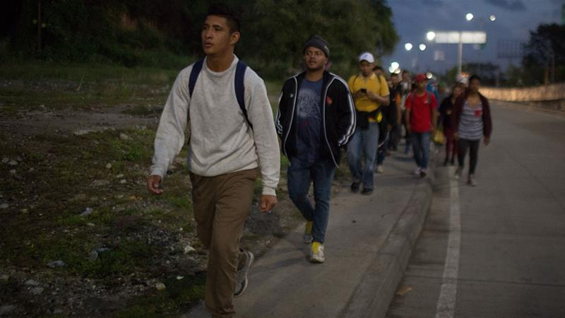 Migrants and asylum seekers part of a new caravan leaving Honduras set off from San Pedro Sula [Jeff Abbott/Al Jazeera]