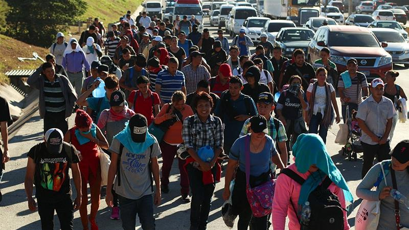 Migrants and refugees begin their journey towards the US border on a highway in San Salvador [Salvador Melendez/AP]