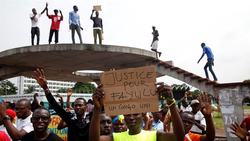 Supporters of Martin Fayulu, runner-up in DR Congo's presidential election, protest in front of the constitutional court as they wait for him to deliver his appeal contesting the results in Kinshasa, January 12, 2019 [File: Baz Ratner/Reuters]