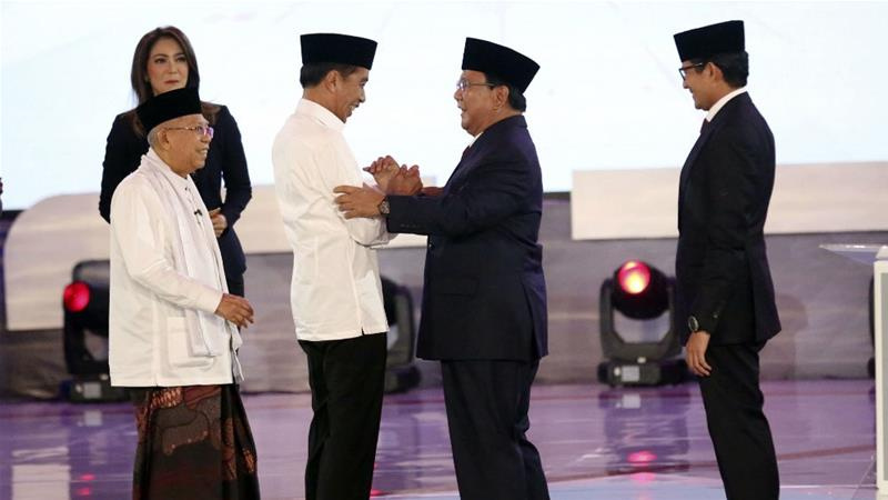 Joko Widodo, second left, and running mate Ma'ruf Amin, left, with rivals Prabowo Subianto, second right, and running mate Sandiaga Uno, right, at the end of their first TV debate [Tatan Syuflana/AP Photo]