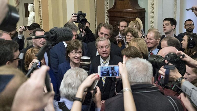 Senator Graham (centre) has repeatedly called for accountability after Khashoggi's murder [File: Shawn Thew/EPA]