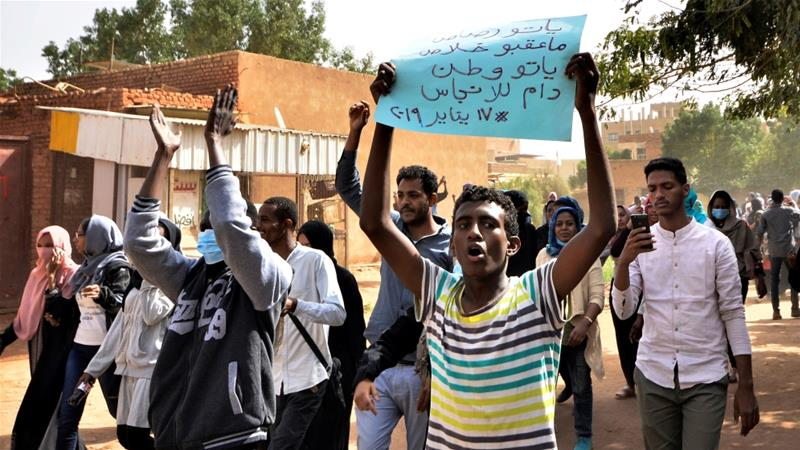 Sudanese demonstrators chant slogans as they participate in anti-government protests in Khartoum [Mohamed Nureldin Abdallah/Reuters]