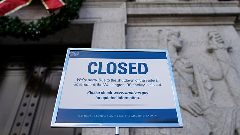A sign declares the National Archive is closed due to a partial federal government shutdown in Washington DC