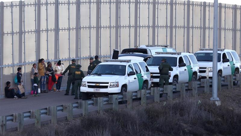 Migrants are held after crossing US-Mexico border [Reuters]