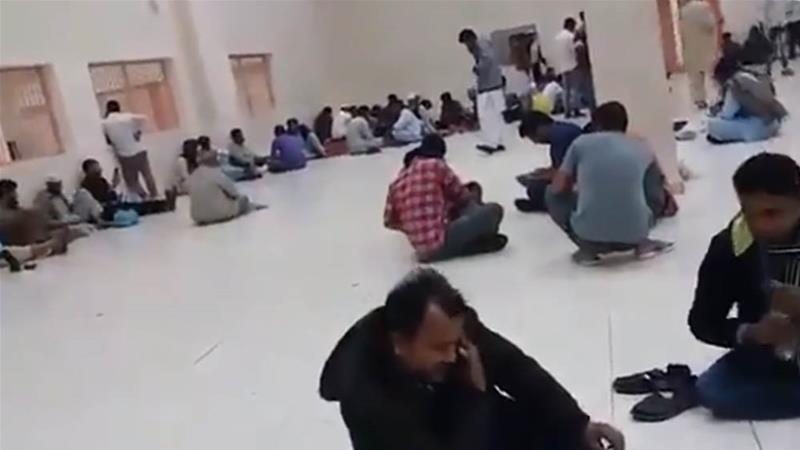 Scores of Rohingya Muslims sit on the floor of the Shumaisi detention centre in Jeddah, as Saudi authorities prepare to deport the men to Bangladesh [Nay San Lwin]