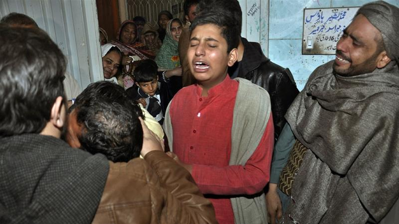 Relatives of the family killed by counterterrorism officers outside their home in Lahore [KM Chaudary/AP}