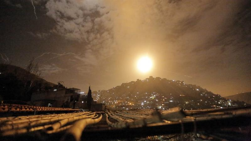 Missiles were seen flying over Damascus near the capital's international airport on Monday [Youssef Badawi/EPA]