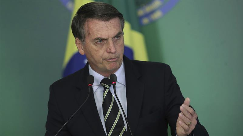 Jair Bolsonaro says Brazil is taking measures to show the country is safe for investments [Eraldo Peres/AP]