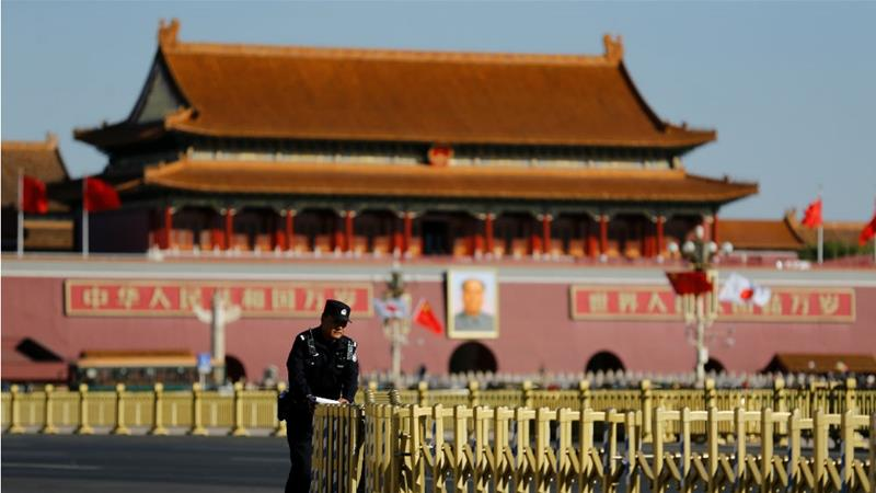 A police officer in front of the Great Hall of the People in Beijing [File:Thomas Peter/Reuters]