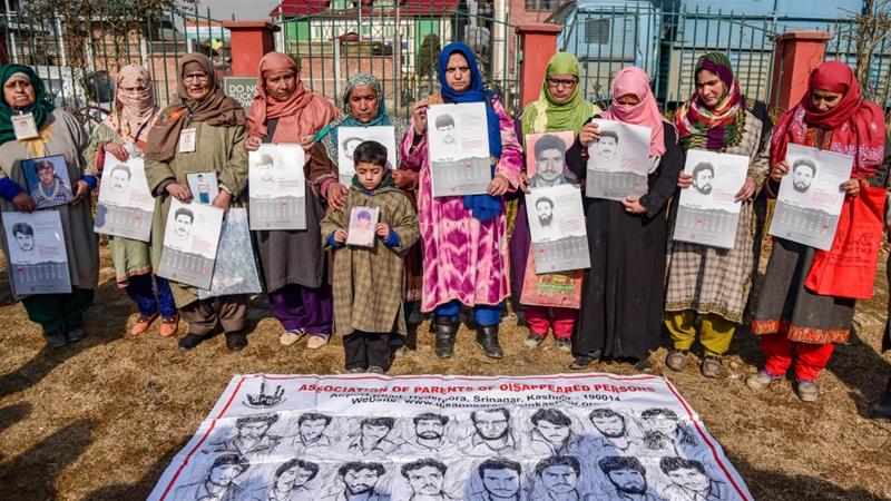 APDP members hold the calendars during a protest in Srinagar. According to APDP more than 8,000 Kashmiris have disappeared since 1989 [Idrees Abbas/SOPA Images/LightRocket/Getty Images]