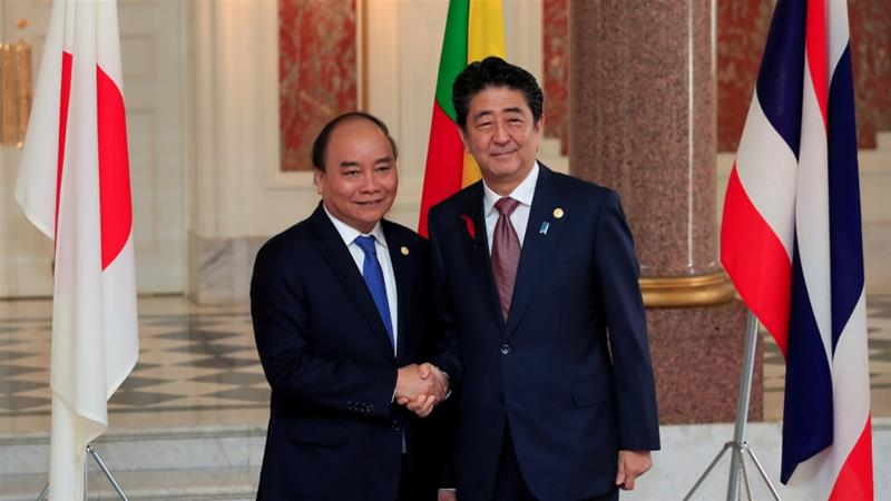 File: Japanese PM Shinzo Abe shakes hands with Vietnam's PM Nguyen Xuan Phuc at the Akasaka Palace State Guest House in Tokyo, Japan, October 9, 2018 [File:Franck Robichon/Reuters]