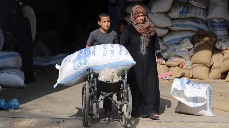Under an informal deal struck in November, $90m in Qatari aid was to have been transferred in six installments to Gaza workers [Ibraheem Abu Mustafa/Reuters]