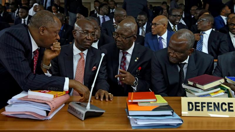 Buhari suspends Onnoghen, swears in new CJN