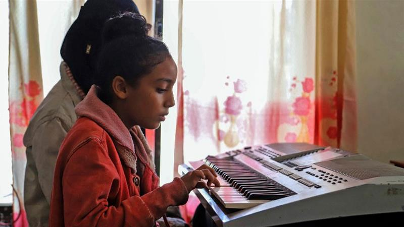 Music helps children living in Taiz, a city once known for its coffee beans, but now a battlefield [Ahmad Al-Basha/AFP]