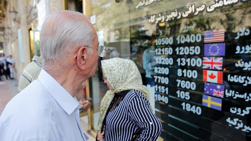 The severest blow to Iran's economy landed in November when its banks were barred from SWIFT [Abedin Taherkenareh/EPA]