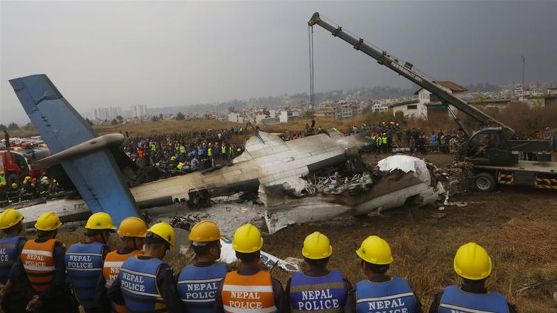 Rescuers and police prepare to comb debris after a passenger plane from Bangladesh crashed at Kathmandu airport [File: AP/Niranjan Shreshta]