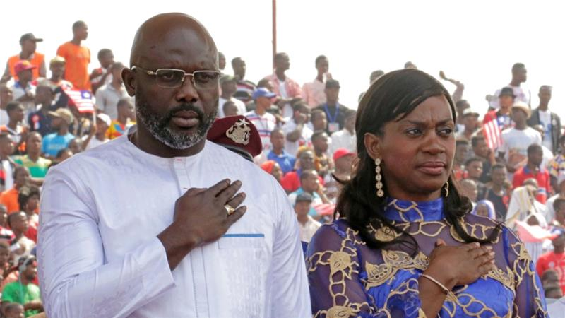Liberia's President Weah stands with his wife Clar during his swearing-in ceremony at the Samuel Kanyon Doe Sports Complex in Monrovia on January 22, 2018 [File: Thierry Gouegnon/Reuters]