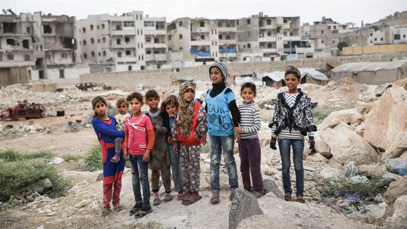 Children stand in the outskirts of al-Bab, northern Syria [File:Lefteris Pitarakis/AP Photo]