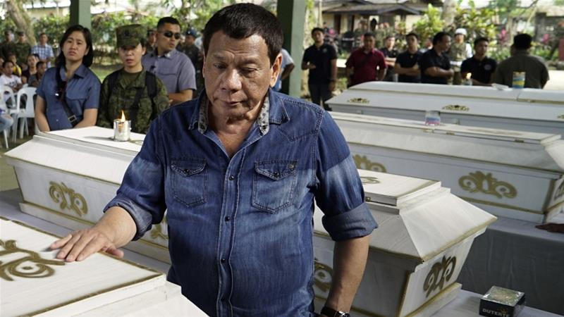 On Monday, Duterte visited the wake of explosion victims in Jolo, Sulu province [King Rodriguez/EPA]
