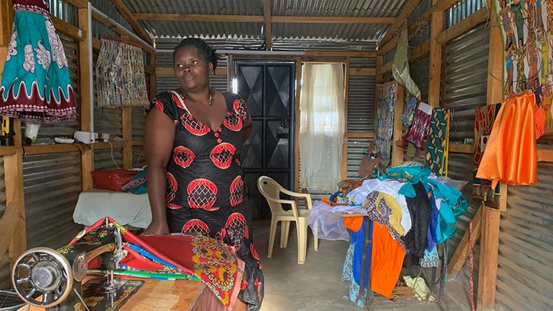 Irene Obahiambo stands in her workshop in Kawangware, Nairobi [William Worley/Al Jazeera]