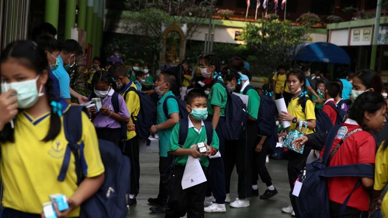 Pupils say they know about the risks posed by the dangerous pollutant particles, known as PM 2.5 [Athit Perawongmetha/Reuters]