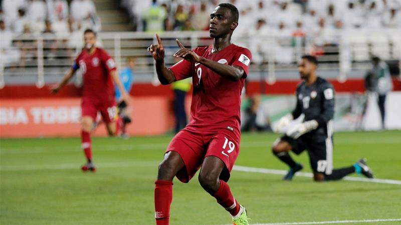 Qatar's Almoez Ali celebrated scoring their second goal against UAE on Tuesday [Thaier Al-Sudani/Reuters]