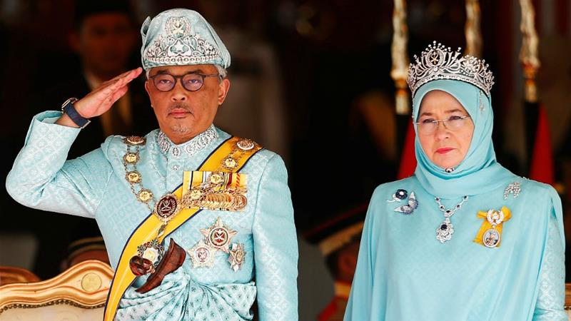 Malaysia's new King Sultan Abdullah Sultan Ahmad Shah and Queen Tunku Azizah Aminah Maimunah at the welcome ceremony outside parliament in Kuala Lumpur [Lai Seng Sin/Reuters]