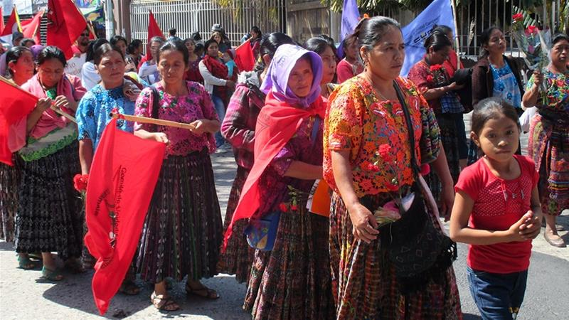 Indigenous survivors of the conflict-era atrocities, the Campesino Unity Committee, and other groups march against a bill that would grant amnesty to those who committed crimes against humanity [Sandra Cuffe/Al Jazeera]
