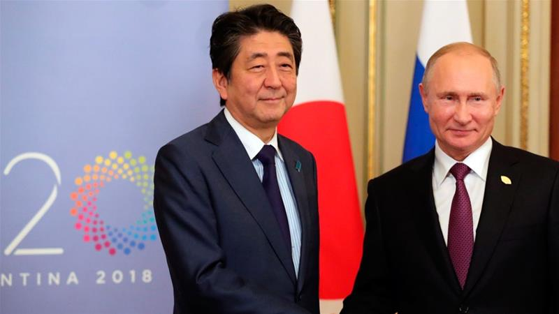 Putin and Abe have held several meetings in a bid to solve the dispute over the islands [File: Mikhail Klimentyev/Sputnik/Kremlin Pool Photo via AP]