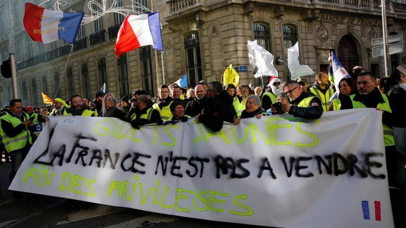 French protesters rail against Macron