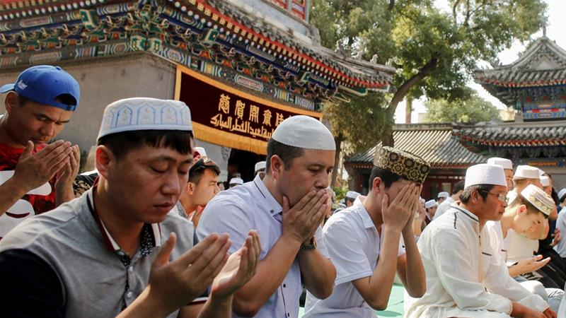 Practicing Islam is forbidden in parts of China, with individuals caught praying, fasting, growing a beard or wearing a hijab facing arrest [Thomas Peter/Reuters]