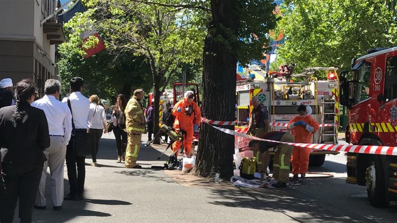 Hazmat and fire crews in Melbourne after reports that multiple suspicious packages had been sent to foreign consulates and embassies [Kaitlyn Offer/AAP Image/AP]