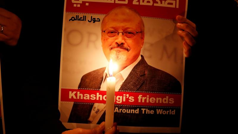 A demonstrator holds a poster with a picture of Saudi journalist Jamal Khashoggi outside the Saudi Arabia consulate in Istanbul, Turkey [File: Osman Orsal/Reuters]