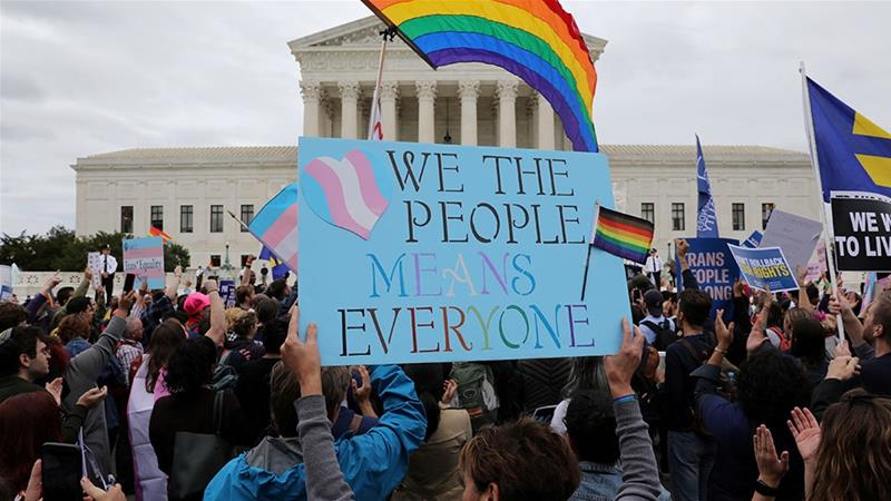 LGBT activists and supporters holding a rally outside the US Supreme Court [File: Jonathan Ernst/Reuters]